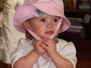 Lexi trying on her hat for next summer's vacation.
