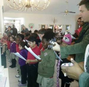 Jordyn, at the nursing home today,  in the purple, near center with the black boots on.
