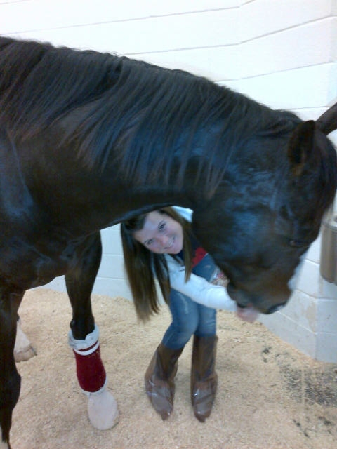 Lauren loving on Bruno after surgery at Texas A&M.