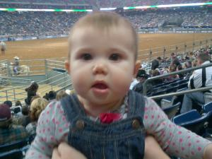 Kendlyll with the Houston Rodeo ring behind her.