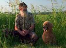 Si with his hunting poodle.