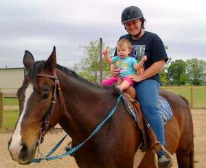 Kendyll FINALLY getting a turn!  She says she was born to ride!