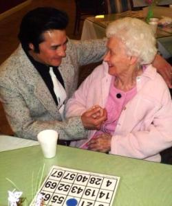 Elvis singing to momma.