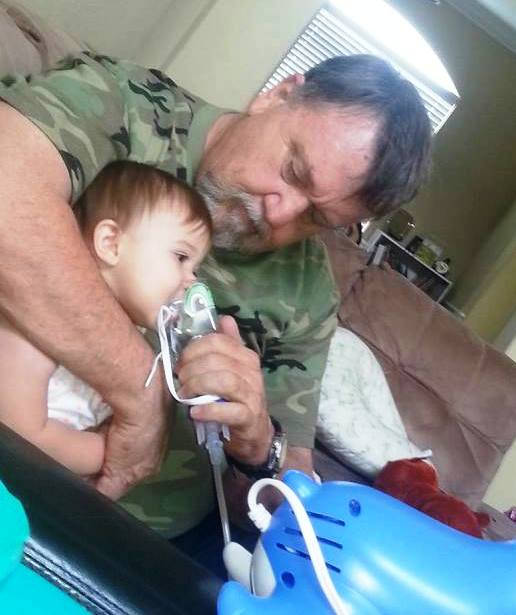 Papa Rick taking care of Kendyll's breathing treatment.  On top of Ally's broken arm, Ken has bronchitis!  Rick can handle it-he was a Marine!