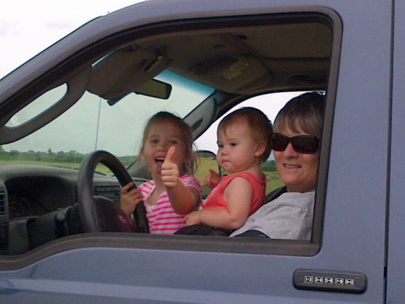 Jo, Kendyll and I all driving the truck as Lauren, Gaylyn and Ally stack hay.