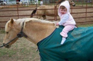 Jordyn totally at home on pony Dusty.