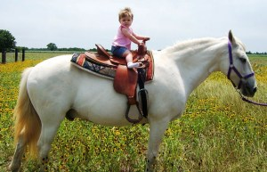 Jordyn at nine months of age on her Snowney.