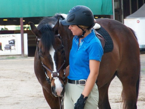 One of my favorite all time pictures of Mickey and Lauren. She is giving him a little pep talk before a jumping class.