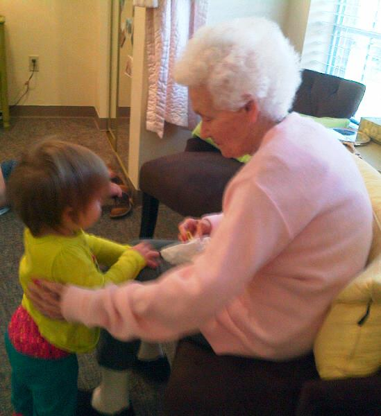 My mother and her great granddaughter, Kendyll, having a serious conversation.