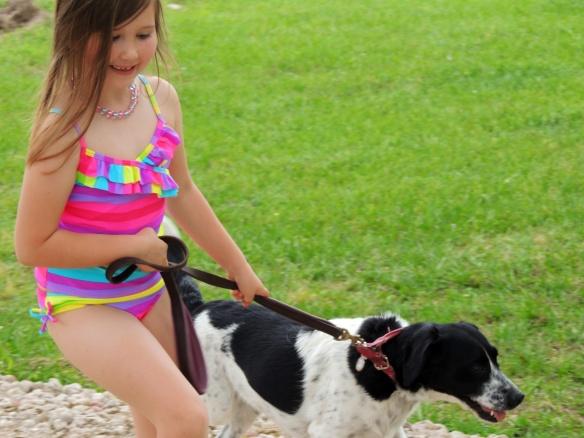 Jordyn walking her favorite dog, Muffy.