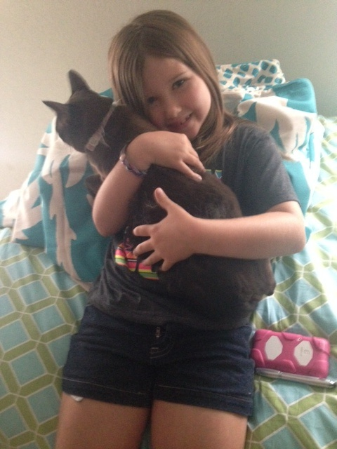 Jordyn loving the new rescued kitty, Bella.