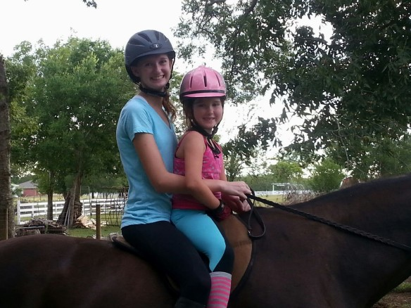 Jo happily accompanying Isabel on a ride.