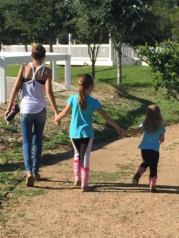 Mia walking with my granddaughters, Jordyn and Kendyll
