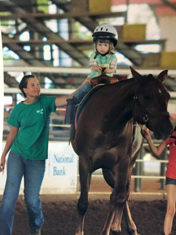 Jordyn, about two, riding in her first barrel race on Drifter with my Lauren and Lauren & Kallyn Davang