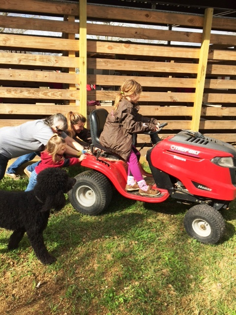 I am pretty sure this is not what my doctor had in mind.  Kendyll is sure doing her part though while Jordyn steers the broken mower.