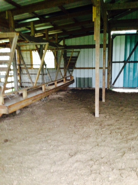 The original view inside the barn with cow troughs.