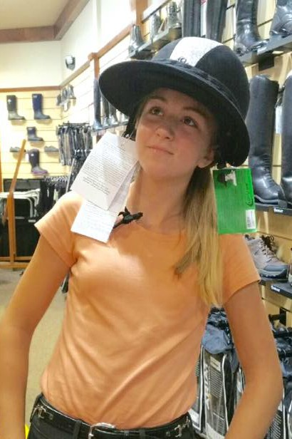 Mia modeling the new helmet visor.  A lot of shopping was included for the students-just ask their parents.